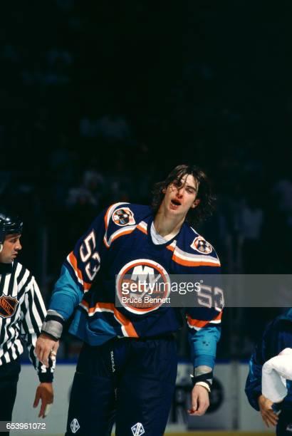 Zdeno Chara of the New York Islanders skates towards the penalty box after an altercation during an NHL preseason game circa 1997 at the Nassau...