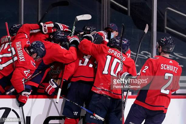 Zdeno Chara of the Washington Capitals celebrates with his teammates after scoring a goal against the New York Islanders in the second period at...