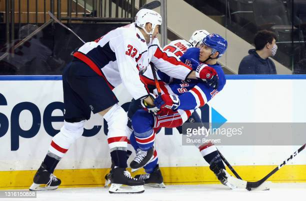 Zdeno Chara of the Washington Capitals hits Ryan Strome of the New York Rangers during the second period at Madison Square Garden on May 03, 2021 in...