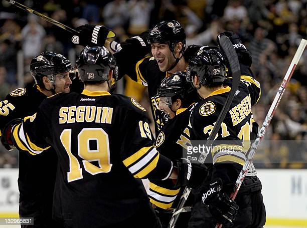 Zdeno Chara, Patrice Bergeron, Tyler Seguin and Johnny Boychuk of the Boston Bruins celebrate teammate Brad Marchand's goal in the third period...