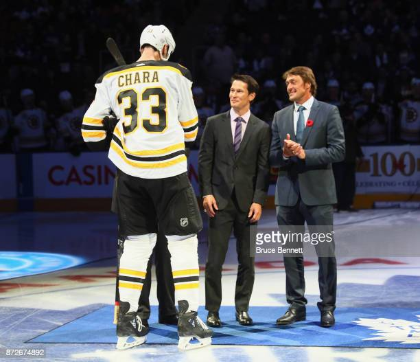 Zdeno Chara Paul Kariya and Teemu Selanne take part in the pregame ceremony prior to the game between the Toronto Maple Leafs and the Boston Bruins...