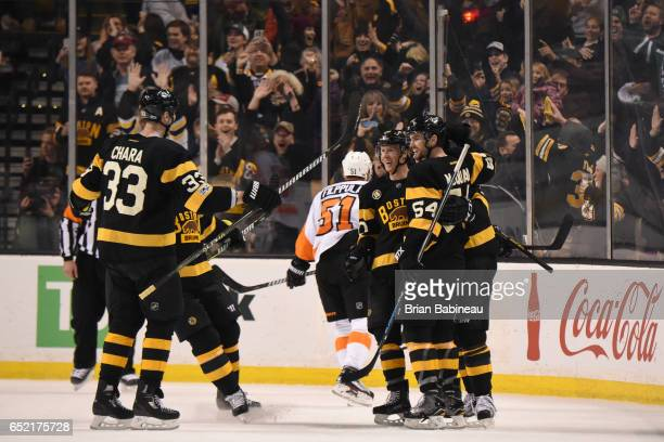 Zdeno Chara Riley Nash and Adam McQuaid of the Boston Bruins celebrate a goal against the Philadelphia Flyers at the TD Garden on March 11 2017 in...