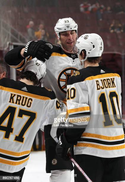 Zdeno Chara Torey Krug and Anders Bjork of the Boston Bruins celebrate after defeating the Philadelphia Flyers 30 on December 2 2017 at the Wells...