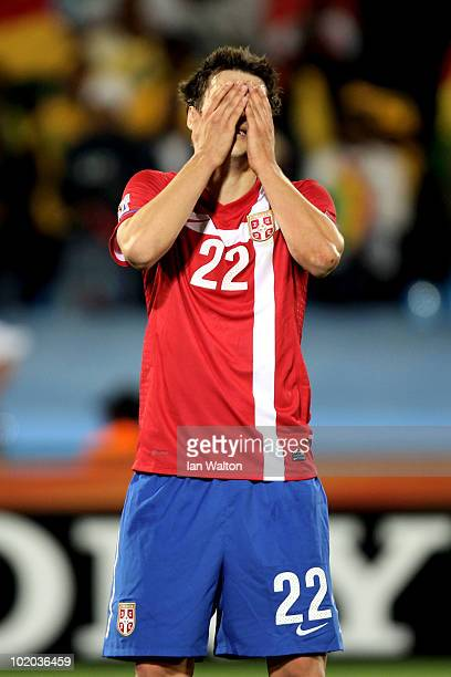 Zdravko Kuzmanovic of Serbia reacts after handling the ball and giving away a penalty during the 2010 FIFA World Cup South Africa Group D match...