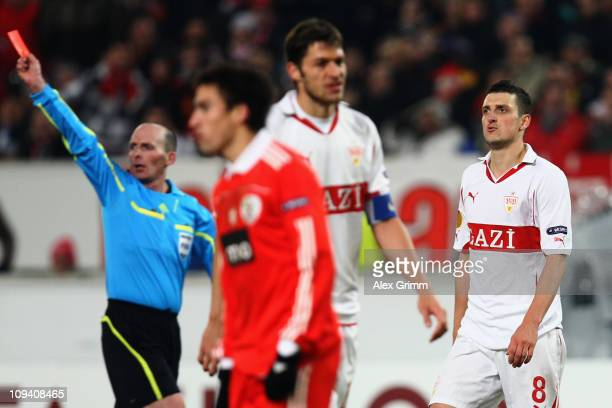 Zdravko Kuzmanovic of Stuttgart is sent off by referee Michael Leslie Dean during the UEFA Europa League match round of 32 second leg between VfB...