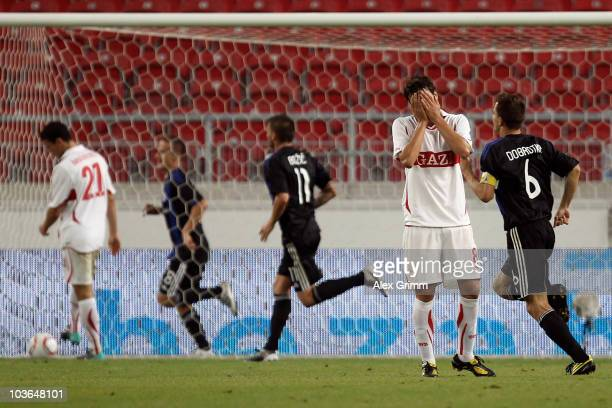 Zdravko Kuzmanovic of Stuttgart reacts as players of Bratislava celebrate their team's second goal during the UEFA Europa League playoff second leg...