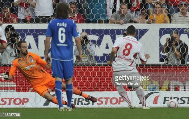 Zdravko Kuzmanovic of Stuttgart scores his teams 2nd goal with a penalty kick past goalkeeper Tom Starke of Hoffenheim during the Bundesliga match...