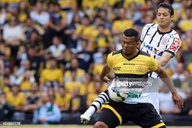Ze Carlos of Criciuma fight for the ball with Anderson Martins of Corinthians during a match between Criciuma and Corinthians as part of Campeonato...