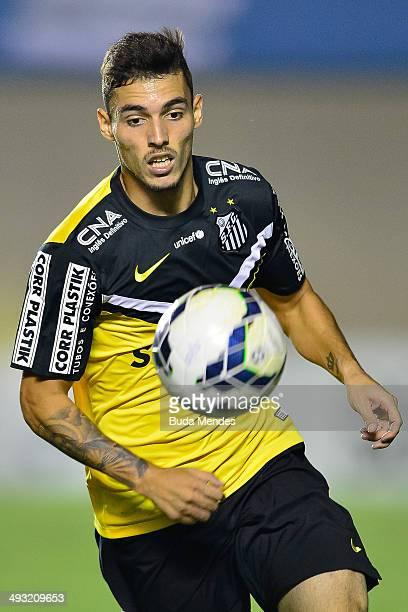 Ze Carlos of Santos struggles for the ball during a match between Goias and Santos as part of Brasileirao Series A 2014 at Serra Dourada Stadium on...