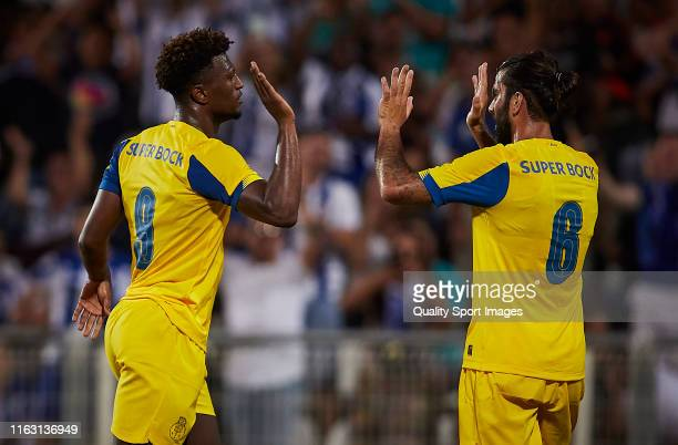 Ze Luis of FC Porto celebrates scoring his team's opening goal with team mates during a pre season friendly match at the Copa Iberica at Estadio...