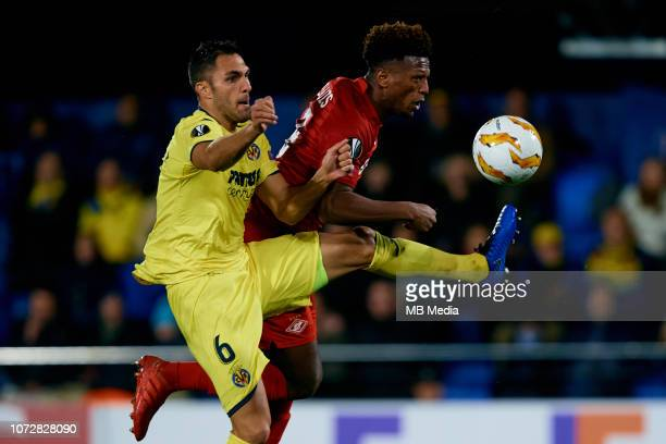 Ze Luis of FC Spartak Moscow competes for the ball with Victor Ruiz of Villarreal CF during the UEFA Europa League Group G match between Villarreal...