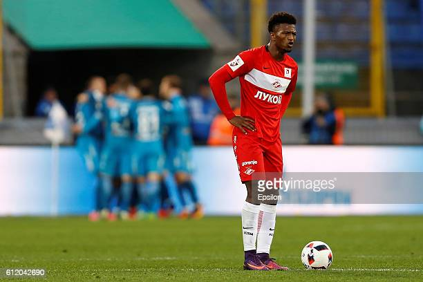 Ze Luis of FC Spartak Moscow reacts as FC Zenit St Petersburg celebrate a goal in the background during the Russian Football League match between FC...