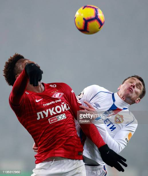 Ze Luis of FC Spartak Moscow vies for the ball with Kirill Nababkin of PFC CSKA Moscow during the Russian Premier League match between FC Spartak...