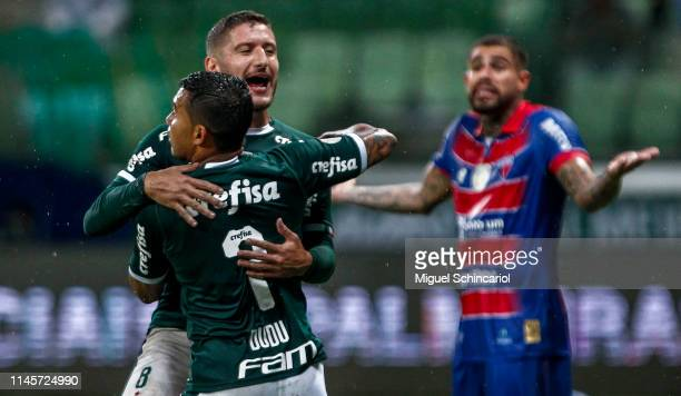 Ze Rafael of Palmeiras celebrates his goal with teammate Dudu during a match between Palmeiras and Fortaleza at Allianz Parque on April 28 2019 in...