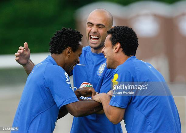 Ze Roberto, Cris and Cincinho of Brazil share a joke during the Brazil National Football Team training session for the FIFA World Cup Germany 2006 at...