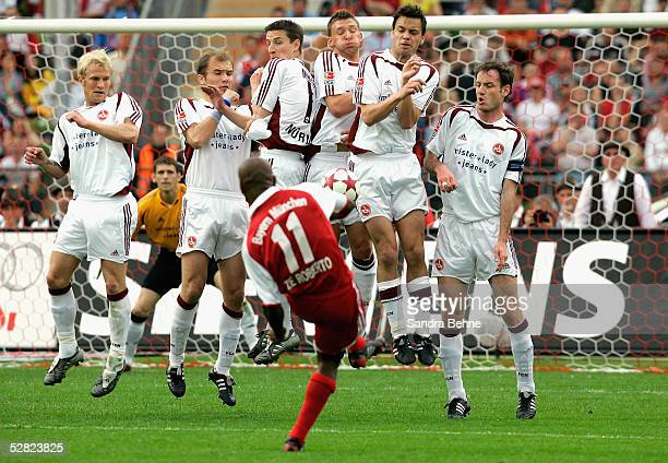 Ze Roberto of Bayern Munich takes a free kick during the Bundesliga match between FC Bayern Munich and 1.FC Nuremberg at the Olympic Stadium on May...
