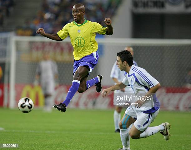 Ze Roberto of Brazil challenges with Konstantinos Katsouranis of Greece during the FIFA Confederations Cup 2005 match between Brazil and Greece on...