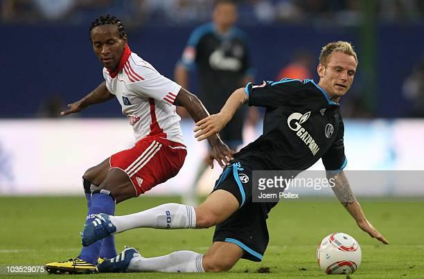 Ze Roberto of Hamburg and Ivan Rakitic of Schalke battle for the ball during the Bundesliga match between Hamburger SV and FC Schalke 04 at Imtech...