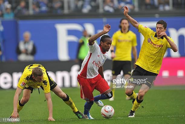 Ze Roberto of Hamburg is challenged by Sven Bender and Robert Lewandowski of Dortmund during the Bundesliga match between Hamburger SV vandBorussia...