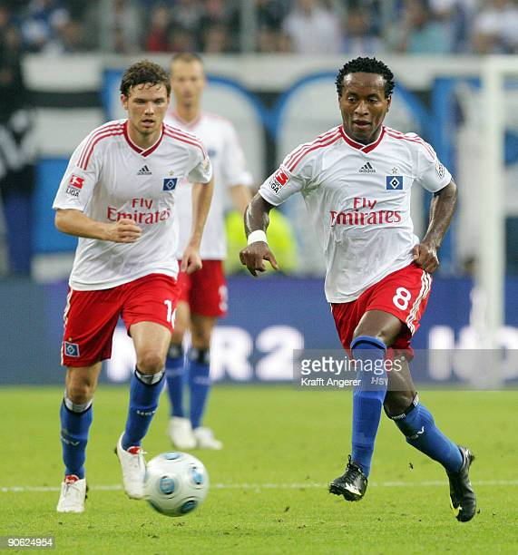 Ze Roberto of Hamburg runs with the ball during the Bundesliga match between Hamburger SV and VfB Stuttgart at HSH Nordbank Arena on September 12...