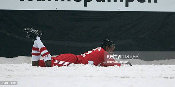 Ze Roberto of Munich has contact with the snow during the friendly match between FC Eintracht Bamberg and FC Bayern Muenchen on January 17, 2009 at...