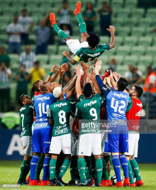 Ze Roberto of Palmeiras celebrates his last match as a professional player with his teammates after the match against Botafogo for the Brasileirao...