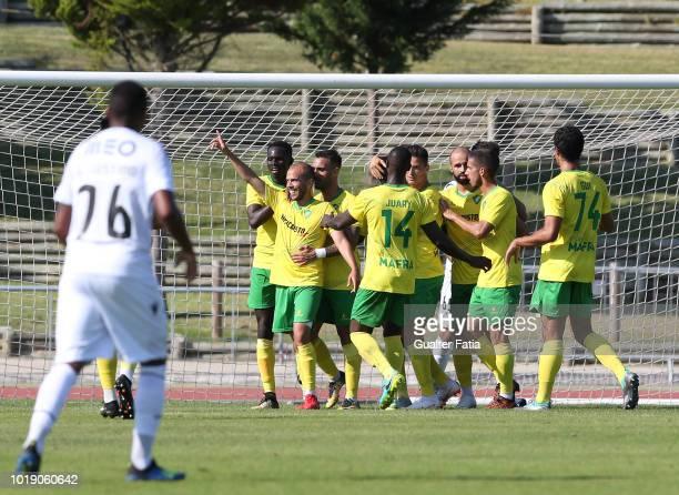 Ze Tiago of CD Mafra celebrates with teammates after scoring a goal during the Portuguese Ledman Liga Pro match between CD Mafra and Vitoria SC B at...