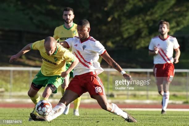 Ze Tiago of CD Mafra tackled by Ulisses Oliveira of UD Vilafranquense during the Liga Pro match between CD Mafra and UD Vilafranquense at Estadio do...