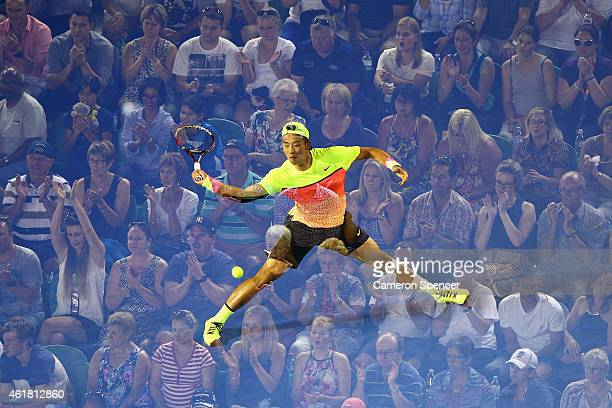 Ze Zhang of China plays a forehand in his first round match against Lleyton Hewitt of Australia during day two of the 2015 Australian Open at...