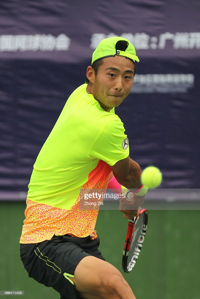 Ze Zhang of China returns a shot during his match against Roberto Marcora of Italy on the ATP Challenger Guangzhou Tour Day 5 at Guangzhou Development District International Tennis School on March 14, 2015 in Guangzhou, China.