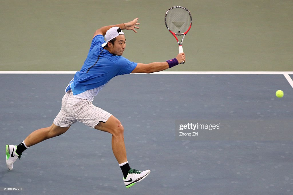 Ze Zhang of China returns a shot during the match against Lukas Lacko of Slovakia during the 2016 'GDD CUP' International ATP Challenger Guangzhou Tour Day 6 at Guangzhou Development District International Tennis School on March 20, 2016 in Guangzhou, China.