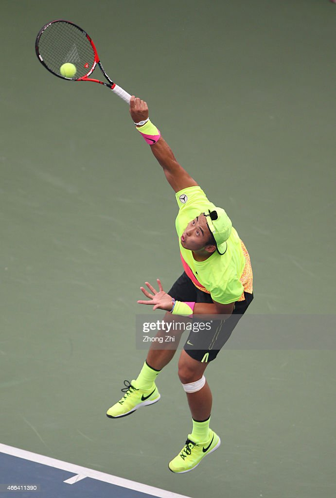 Ze Zhang of China serves during his match against Roberto Marcora of Italy on the ATP Challenger Guangzhou Tour Day 5 at Guangzhou Development District International Tennis School on March 14, 2015 in Guangzhou, China.