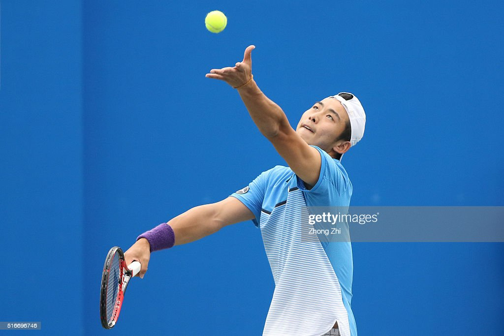 Ze Zhang of China serves during the match against Lukas Lacko of Slovakia during the 2016 'GDD CUP' International ATP Challenger Guangzhou Tour Day 6 at Guangzhou Development District International Tennis School on March 20, 2016 in Guangzhou, China.