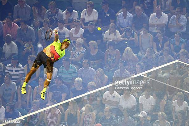 Ze Zhang of China serves in his first round match against Lleyton Hewitt of Australia during day two of the 2015 Australian Open at Melbourne Park on...