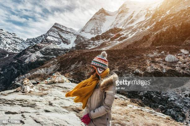 Zealand-based Scenic Spot of Daocheng Yading snow-capped mountains under the young girl