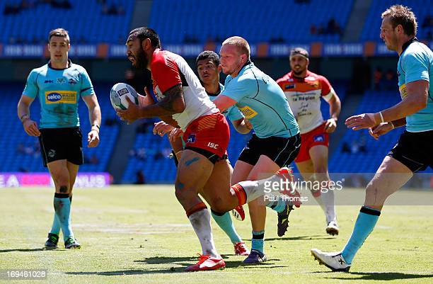 Zeb Taia of Catalan wins the ball to score a try during the Super League Magic Weekend match between Catalan Dragons and London Broncos at the Etihad...