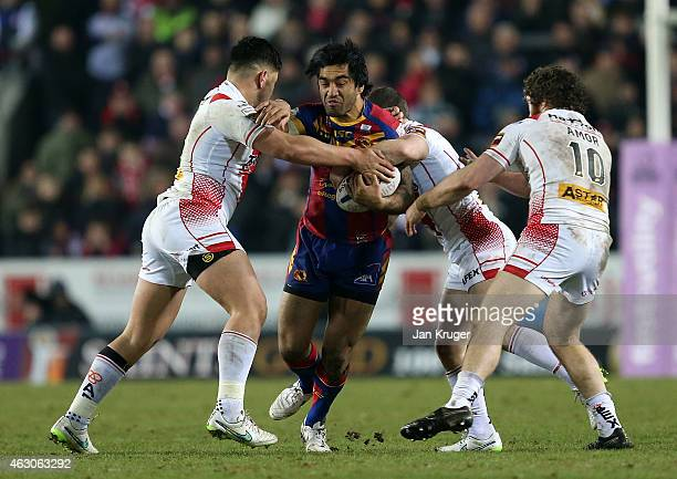 Zeb Taia of Catalans Dragons is tackled by Andre Savelio of St Helens during the First Utility Super League match between St Helens and Catalans...