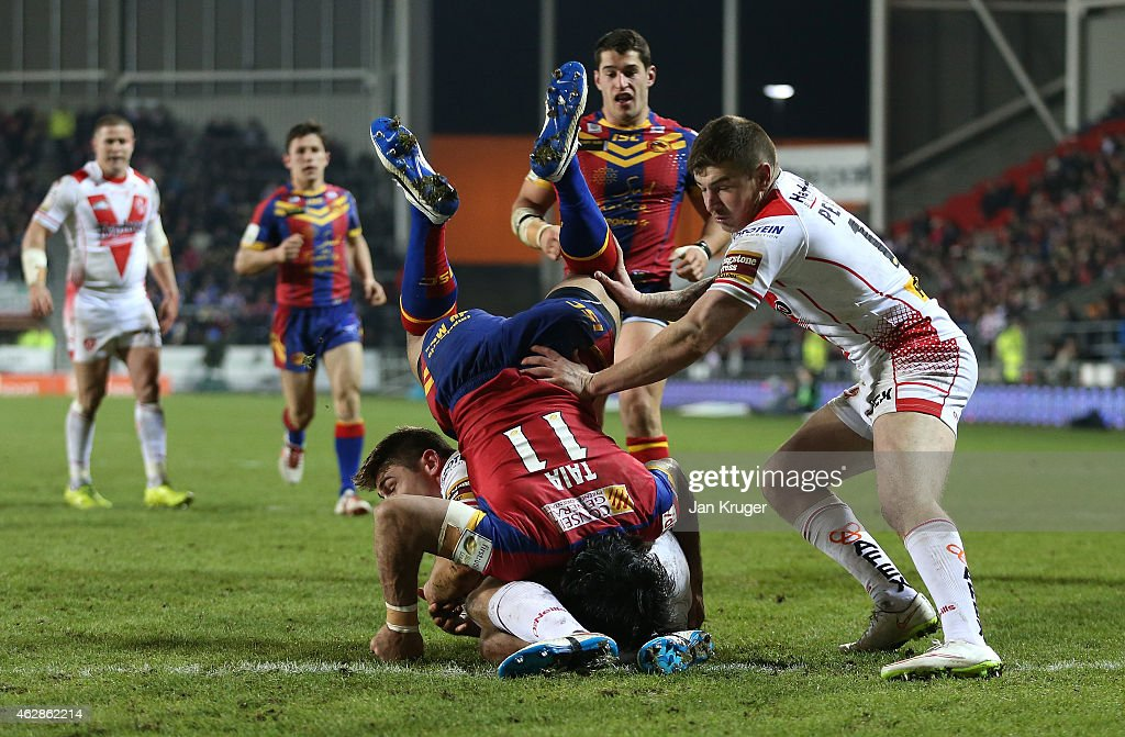 Zeb Taia of Catalans Dragons looses his footing in a tackle during the First Utility Super League match between St Helens and Catalans Dragons at Langtree Park on February 6, 2015 in St Helens, England.