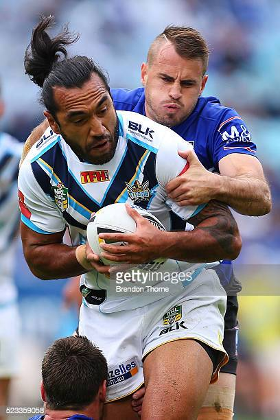 Zeb Taia of the Titans is tackled by Josh Reynolds of the Bulldogs during the round eight NRL match between the Canterbury Bulldogs and the Gold...