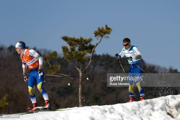 Zebastian Modin and his guide Robin Bryntesson of Sweden compete in the Men's Cross Country 15km Sprint Classic Final Visually Impaired event at...