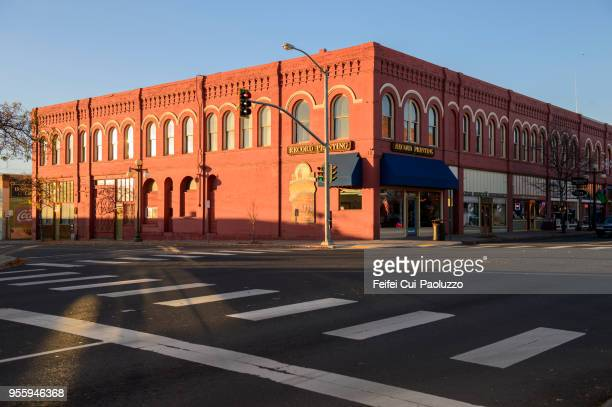 zebra crossing and city street at ellensburg, washington, usa - small town america stock pictures, royalty-free photos & images