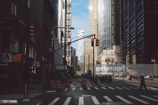 zebra crossing on city street amidst modern buildings - bortes stockfoto's en -beelden