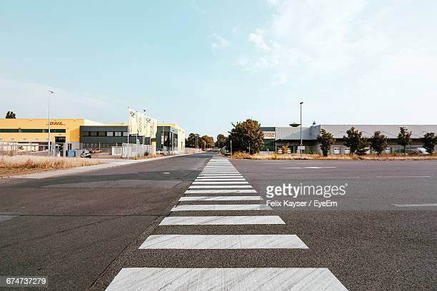 zebra crossing on road against sky - zebra crossing stock pictures, royalty-free photos & images