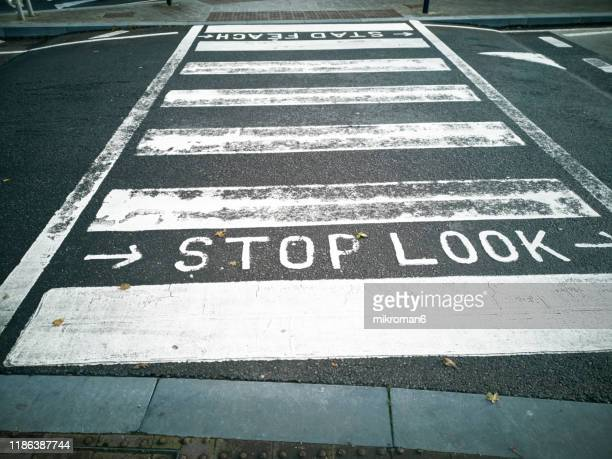 zebra crossing on street - urban road stock pictures, royalty-free photos & images