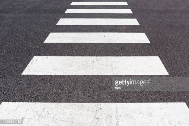 zebra crossing - road marking stock pictures, royalty-free photos & images