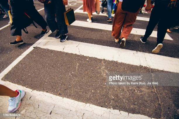 zebra crossing with lot of pedestrians walked on it at taipei street. - taiwan stock pictures, royalty-free photos & images