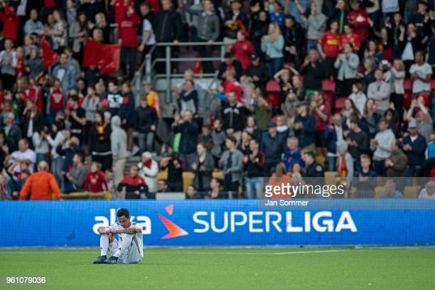 Zeca of FC Copenhagen sits in disbelief after the 00 result against FC Nordsjaelland that dropped FC Copenhagen outside the medals in the danish Alka...