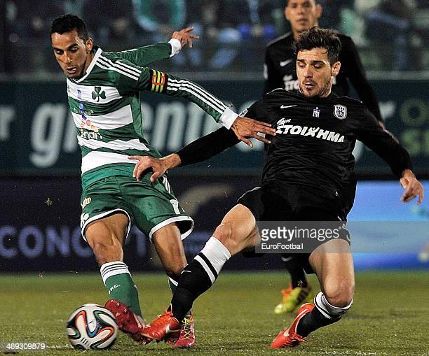 Zeca of Panathinaikos is tackled by Kostas Katsouranis of PAOK during the Greek Superleague between Panathinaikos and PAOK at the Apostolos...