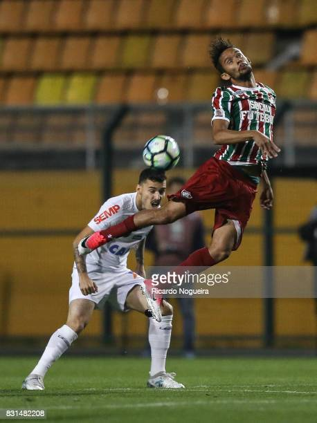 Zeca of Santos battles for the ball with Gustavo Scarpa of Fluminense during the match between Santos and Fluminense as a part of Campeonato...