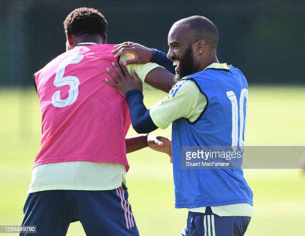 Zech Medley and Alex Lacazette of Arsenal during a training session at London Colney on July 06, 2020 in St Albans, England.